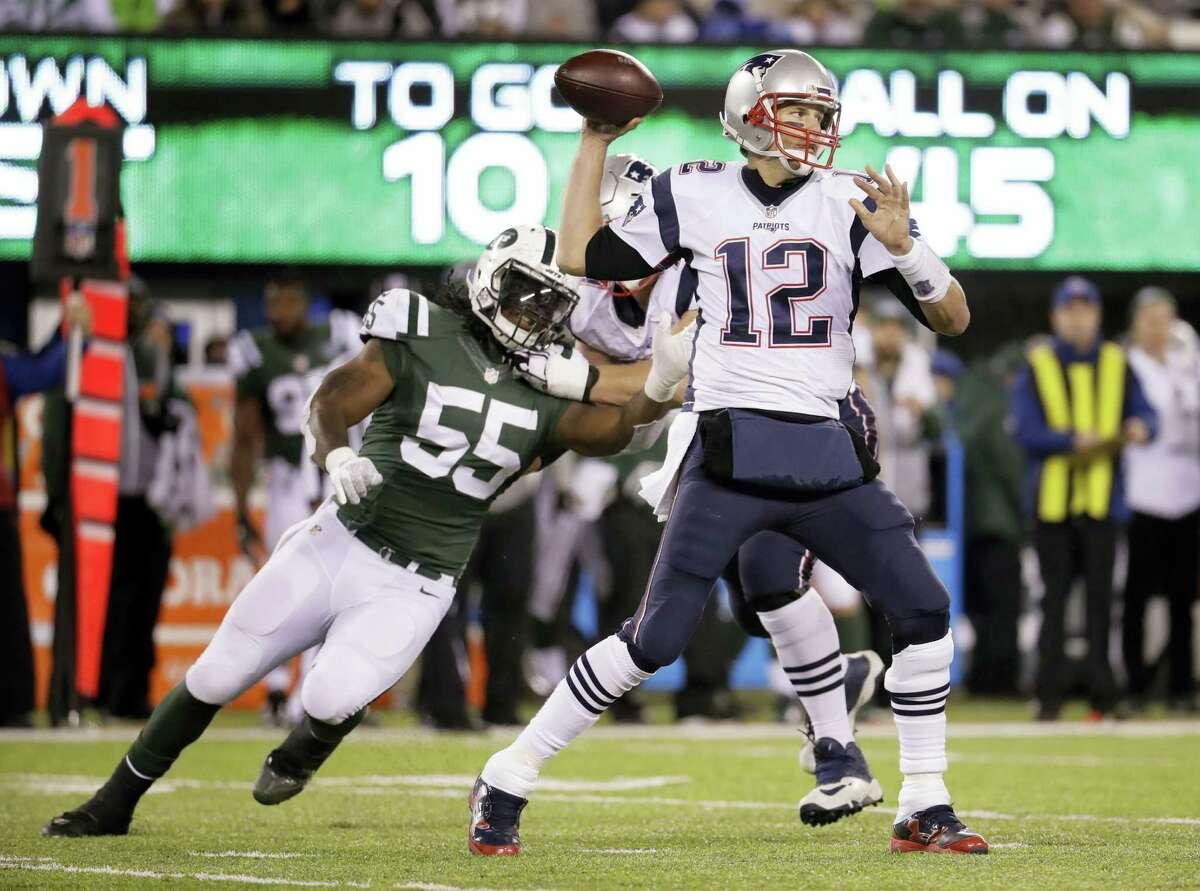 Patriots quarterback Tom Brady throws under pressure from Jets outside linebacker Lorenzo Mauldin during the third quarter Sunday.