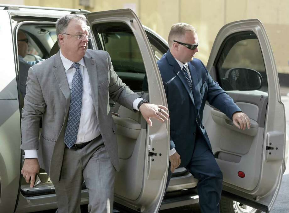 Officer Garrett Miller, right, one of the six members of the Baltimore Police Department charged in connection to the death of Freddie Gray, arrives with attorney Michael Davey at a courthouse for his pre-trial proceedings in Baltimore, Wednesday, July 27, 2016. Photo: AP Photo/Steve Ruark   / FR96543 AP