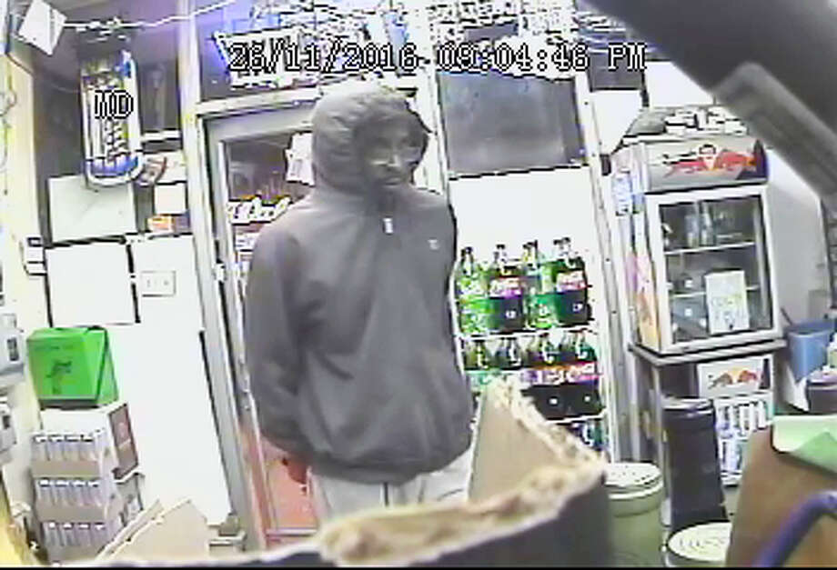 Authorities say this man robbed Sal's Package Store on East Main Street Saturday evening after telling the clerk he had a weapon concealed in a bandana. Photo: Courtesy Middletown Police