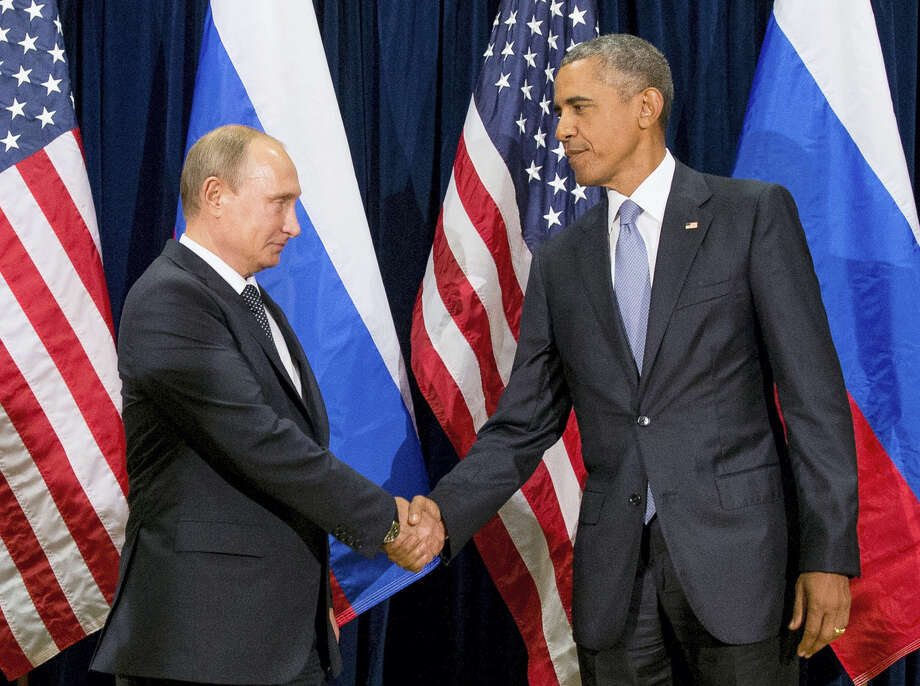 In this Sept. 28, 2015 photo, President Barack Obama shakes hands with Russian President President Vladimir Putin before a bilateral meeting at United Nations headquarters. President Barack Obama's decision to identify Russia as almost certainly the culprit in hacking the Democratic National Committee and releasing politically embarrassing emails fits his administration's new penchant for openly blaming foreign governments for such break-ins. Photo: AP Photo/Andrew Harnik, File  / AP