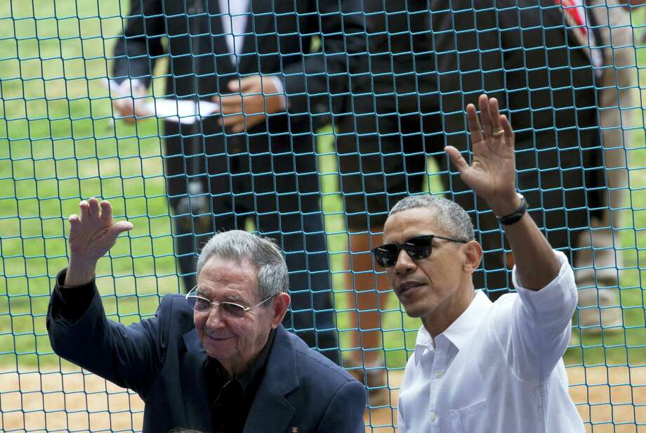This file photo shows U.S. President Barack Obama, right, and his Cuban counterpart Raul Castro wave to cheering fans as they arrive for a baseball game between the Tampa Bay Rays and the Cuban national baseball team, in Havana, Cuba. Castro's passing removes what was long the single greatest psychological barrier to a warmer U.S.-Cuban relationship. But it also adds to the uncertainty ahead with the transition from an Obama to Trump administration. Photo: Rebecca Blackwell — The Associated Press File  / AP