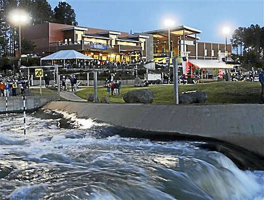 In this April 12, 2012, file photo, water rushes along the course at the National Whitewater Center at dusk on the first day of competition in the canoe slalom Olympic trials, in Charlotte, N.C. The chlorination and filtration systems at the artificial water rapids course where Olympic kayakers train were inadequate to kill a rare, brain-attacking organism, the U.S. Centers for Disease Control and Prevention said Friday, July 1, 2016, after an Ohio teenager died from the amoeba. Photo: Robert Lahser/The Charlotte Observer Via AP, File