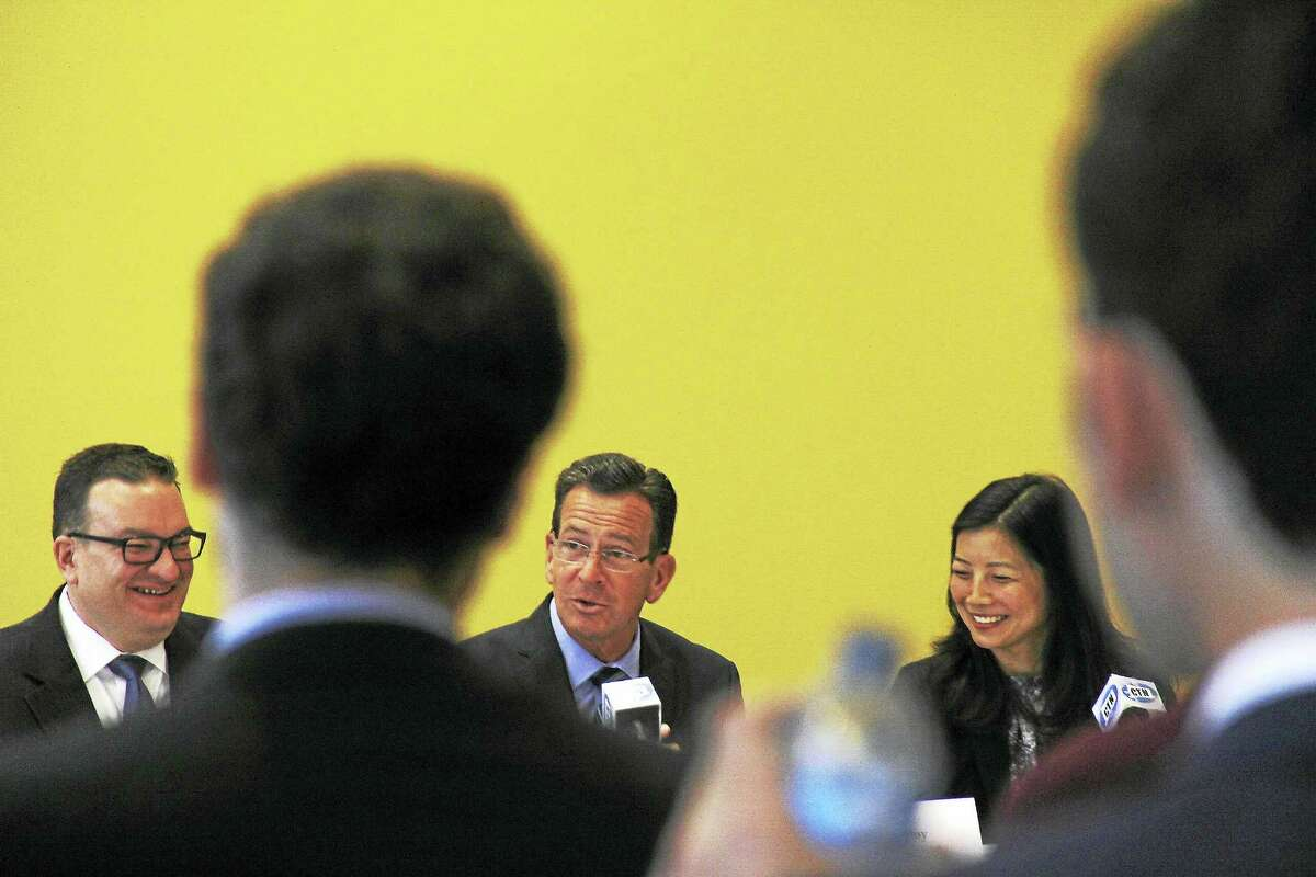 """The Connecticut Family Stability Pay for Success Project is a partnership between the state Department of Children and Families, Family-Based Recovery Services at the Yale Child Study Center, and the Boston-based nonprofit Social Finance. Gov. Dannel P. Malloy, center, spoke about FBR's success at the panel. """"We're making efforts to give families support they need,"""" he said."""