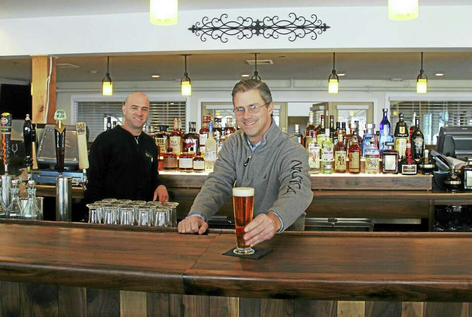 Chef Kevin Cottle joins manager Duncan Ferguson behind the bar at Fire at the Ridge, a new upscale restaurant at Powder Ridge Park in Middlefield. Photo: Kathleen Schassler — The Middletown Press  / Kathleen Schassler All Rights