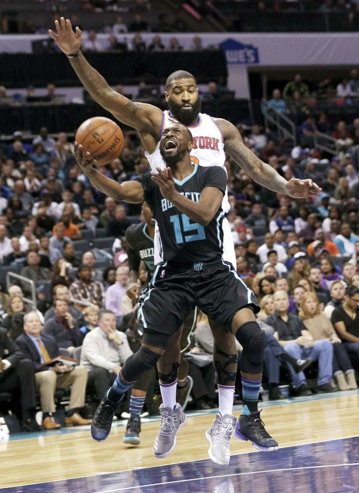 Kemba Walker (15) drives past the Knicks' Kyle O'Quinn in the first half Saturday.
