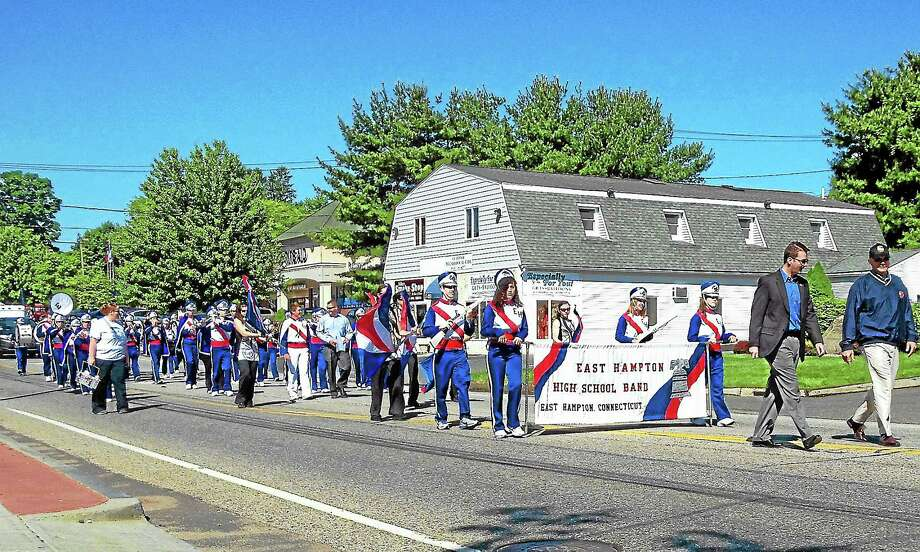 The East Hampton High School Band plays and steps in time during a previous East Hampton Memorial Day Parade. Photo: Press File Photo