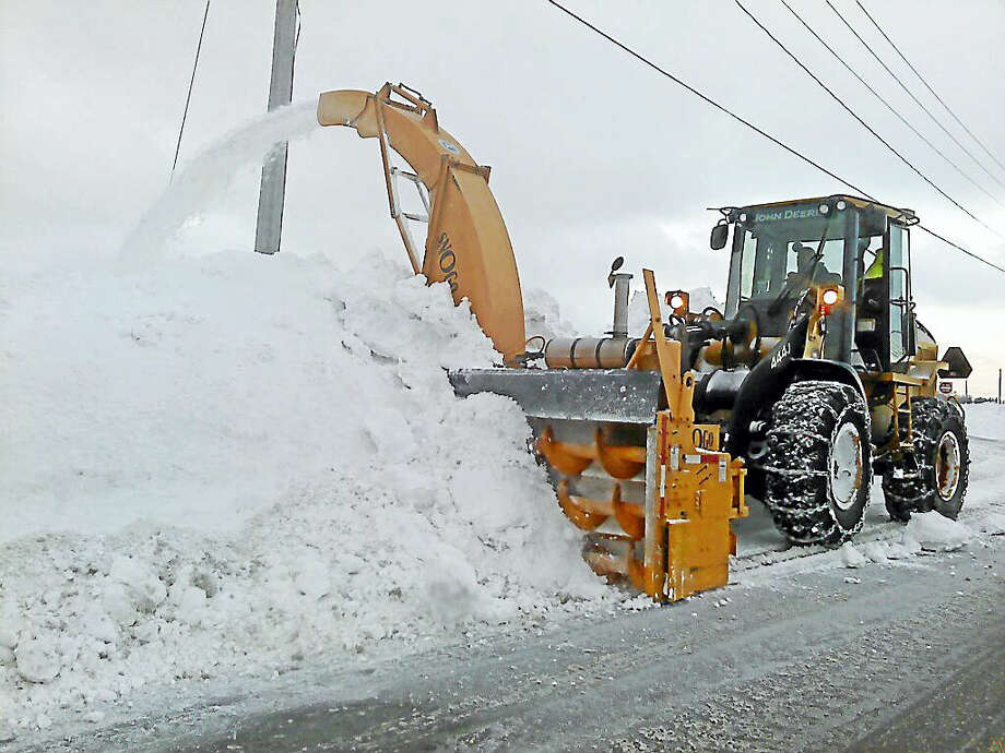 The Connecticut Department of Transportation will send two seven-person crews and equipment to Maryland and Washington, D.C., to help with snow removal. Photo: Contributed Photo