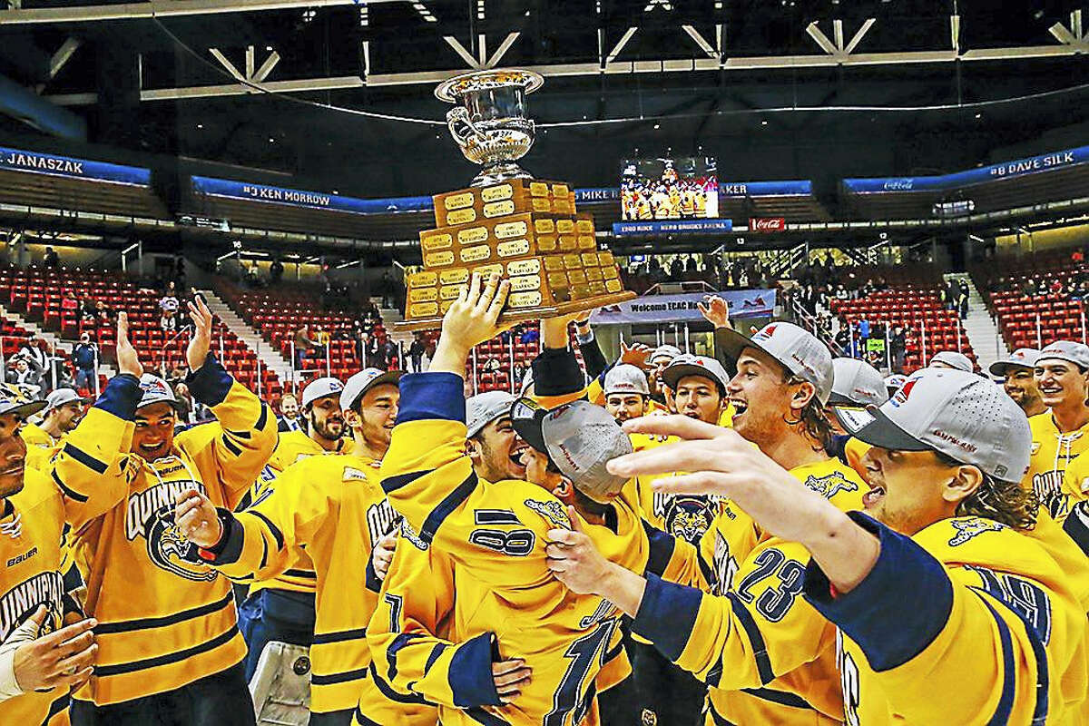 The Quinnipiac men's hockey team holds up the ECAC Hockey tournament championship trophy earlier this month. Register columnist Chip Malafronte says it's probably in the Bobcats best interest to remain in ECAC Hockey, rather than accept any invitation to fill the newly created vacancy in Hockey East.