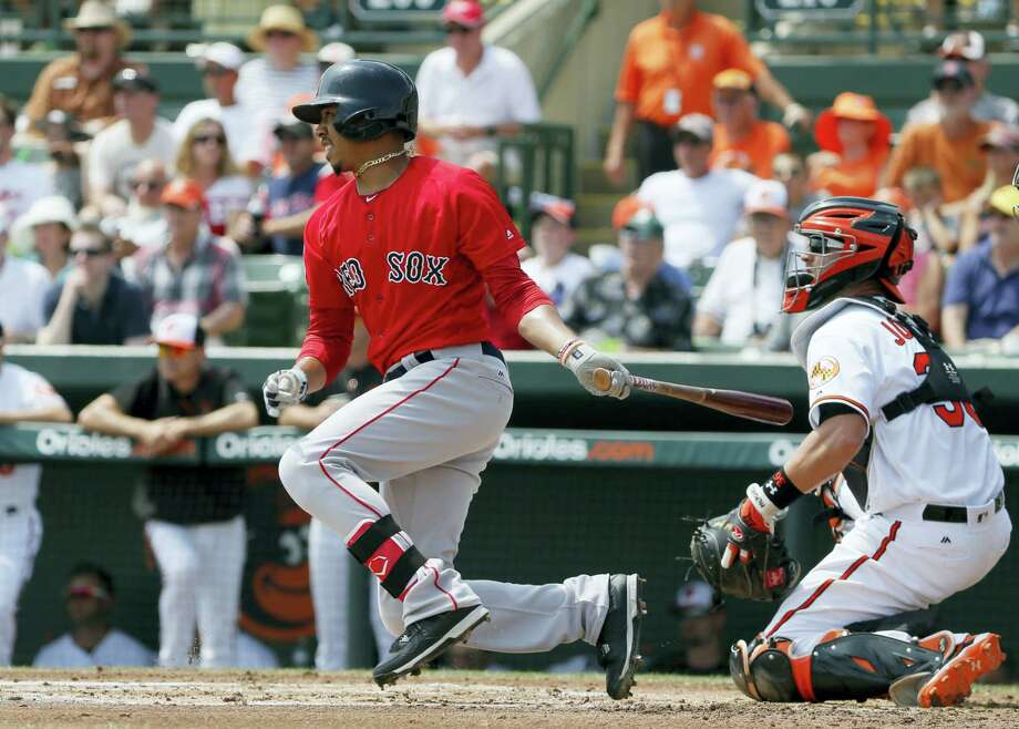 Mookie Betts follows through on a run-scoring single against the Orioles on Saturday. Photo: Tony Gutierrez — The Associated Press  / AP