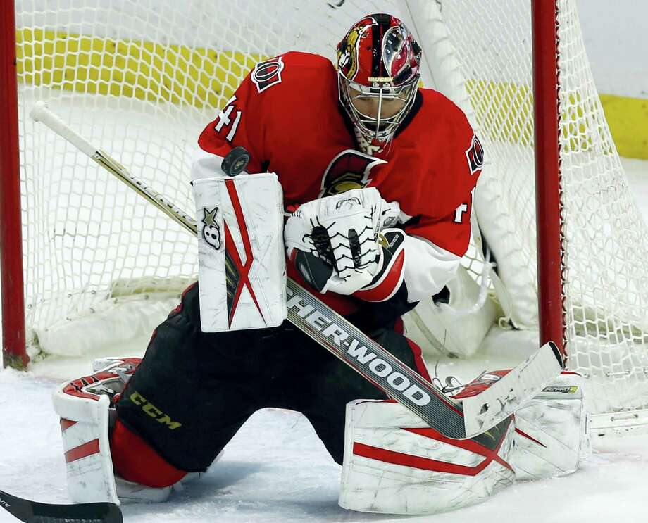Senators Craig Anderson (41) makes a save during third period NHL action against the New York Rangers, in Ottawa, Canada, Sunday, Jan. 24, 2016. The Senators won, 3-0. (Fred Chartrand/The Canadian Press via AP) MANDATORY CREDIT Photo: AP / The Canadian Press