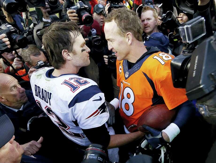 New England Patriots quarterback Tom Brady, left, and Denver Broncos quarterback Peyton Manning after the Broncos defeated the Patriots 20-18 Sunday to advance to Super Bowl. Photo: David Zalubowski – The Associated Press  / AP
