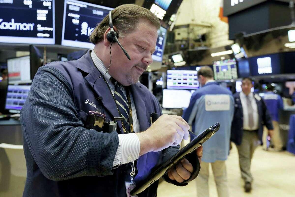 Trader John Santiago works on the floor of the New York Stock Exchange Wednesday.