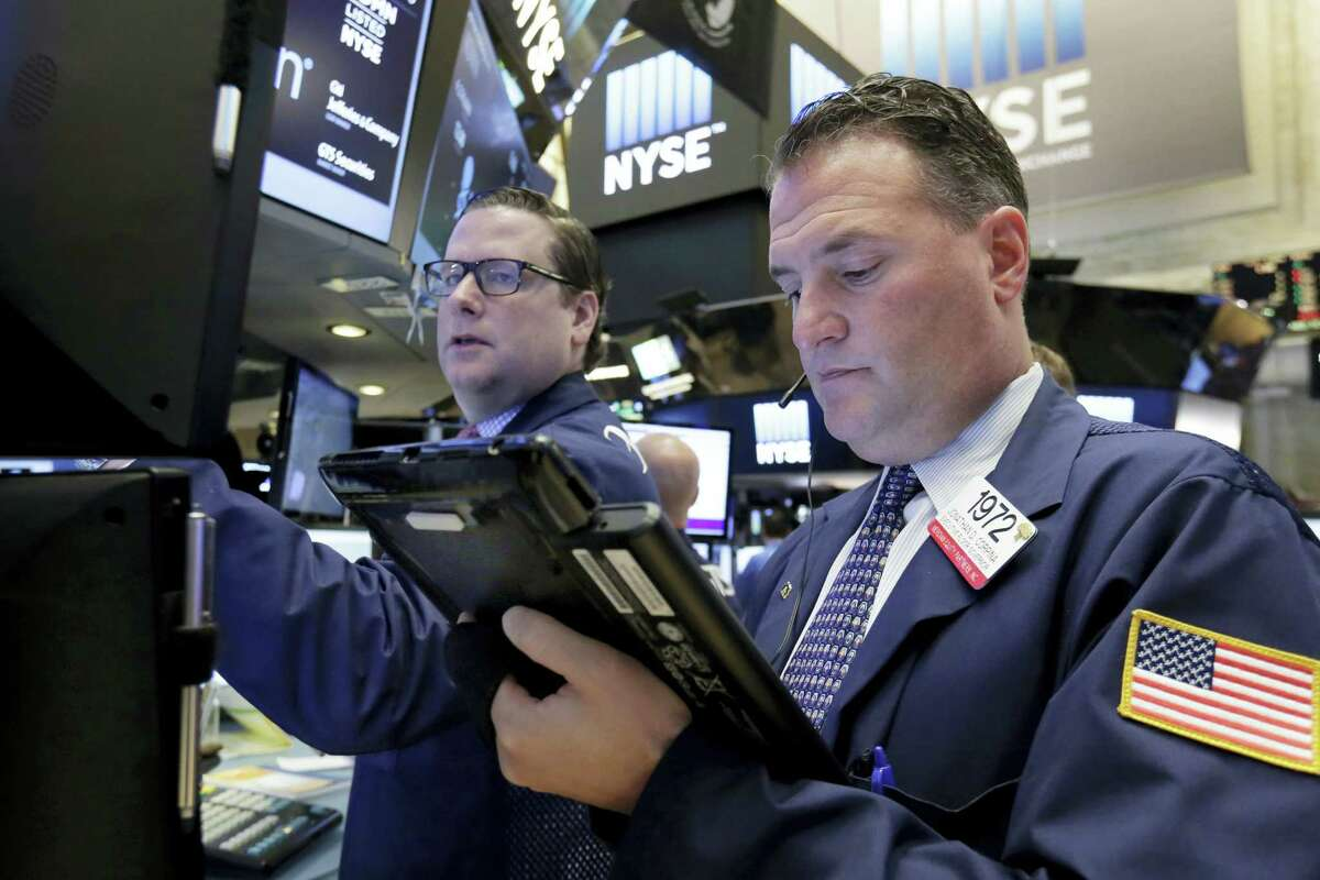Trader Jonathan Corpina, right, works on the floor of the New York Stock Exchange Wednesday.