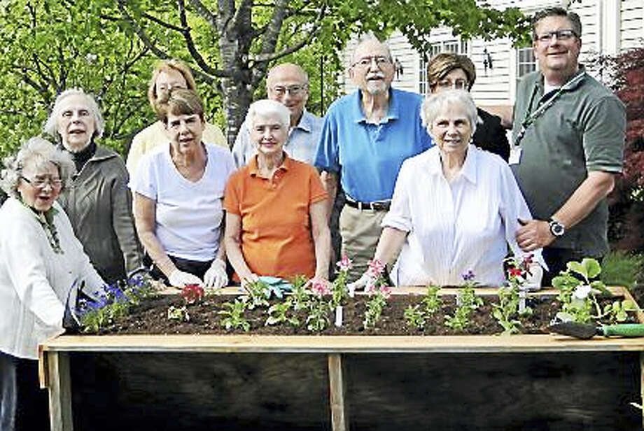 Jeff Eleveld the Plant Guy is shown with one of his raised beds that are table height. He'll be giving a presentation at the Deep River library. His therapeutic horticulture brings people together, Photo: Courtesy Photo