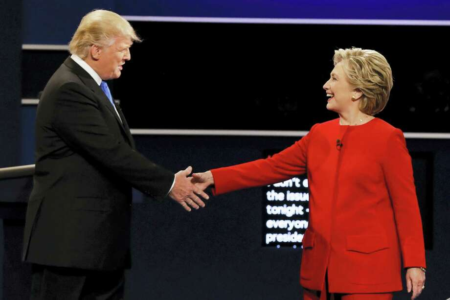Republican presidential nominee Donald Trump and Democratic presidential nominee Hillary Clinton shake hands during the presidential debate at Hofstra University in Hempstead, N.Y., Monday. Photo: The Associated Press  / Copyright 2016 The Associated Press. All rights reserved.