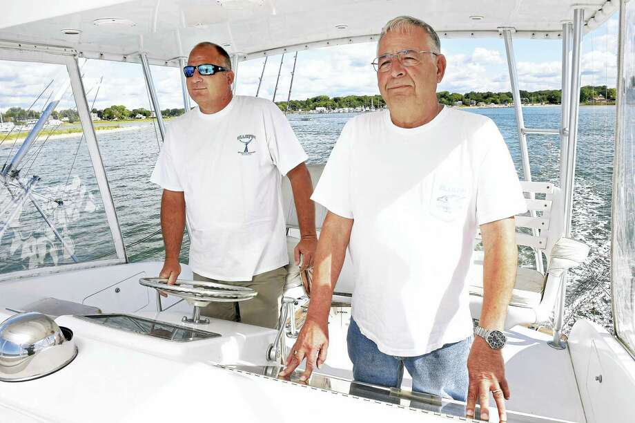 Mike Marro, left, and his father, Nick, owners of Bluefin Sportfishing Charters, are shown aboard the Bluefin, their 44-foot custom sport fishing boat in Clinton Harbor. Photo: Arnold Gold — New Haven Register
