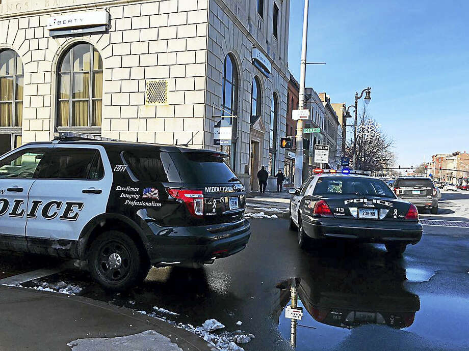 Police converged on Liberty Bank on Main Street Monday morning after a robbery. Photo: Sam Norton — The Middletown Press