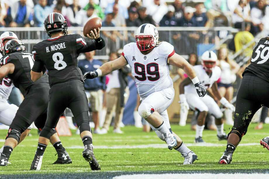 UConn defensive lineman Sean Marinan (99) goes after Cincinnati quarterback Hayden Moore earlier this season. Photo: Icon Sportswire — The Associated Press File Photo  / SPTSW