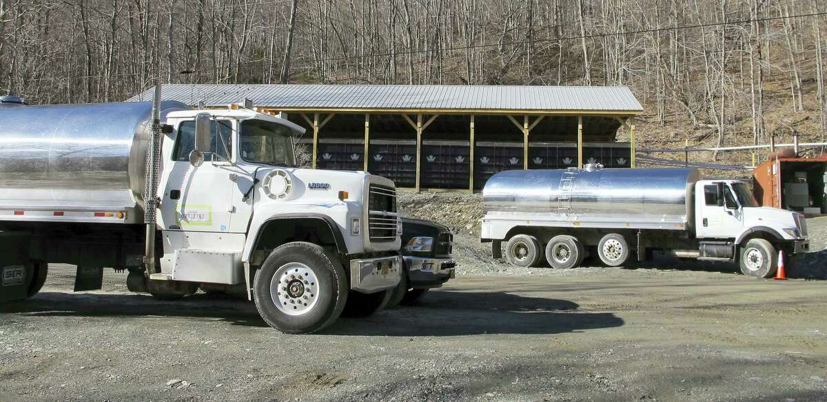 Tanker trucks sit parked at Crown Maple's operation in Sandgate, Vt. The company bought 4,500 acres in southern Vermont and trucks the sap to New York to be processed into maple syrup.
