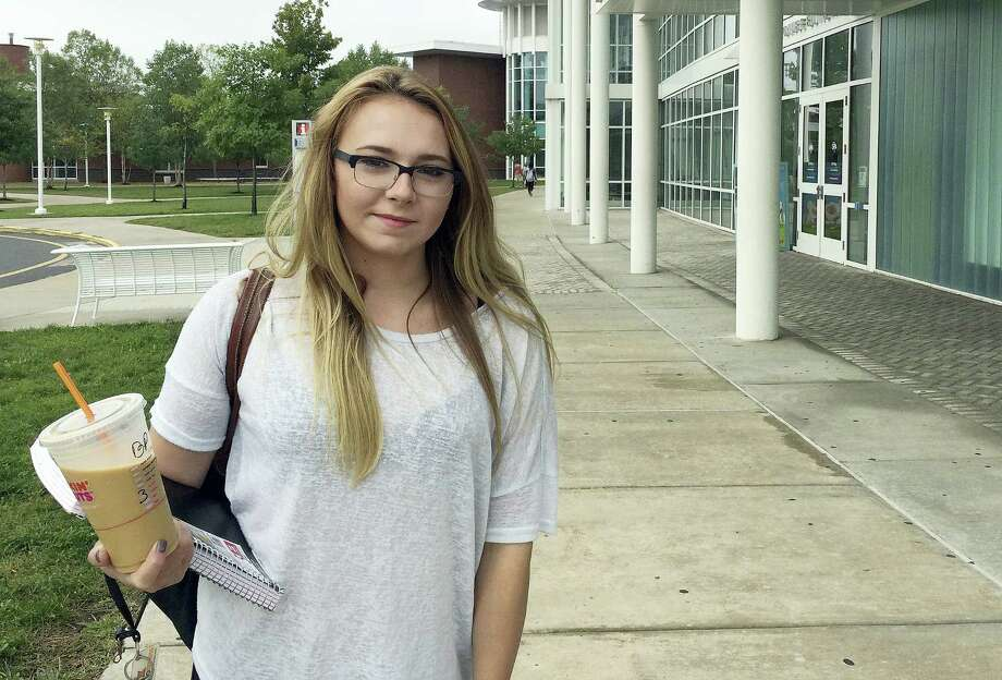 In this Sept. 20, 2016 photo, Manchester Community College student Jeslyn Lamonte, of Vernon, Conn., stands on the school's campus in Manchester, Conn. She said she intends to transfer to UConn after two years to save on tuition and avoid significant education debt. Photo: AP Photo/Michael Melia  / Copyright 2016 The Associated Press. All rights reserved.