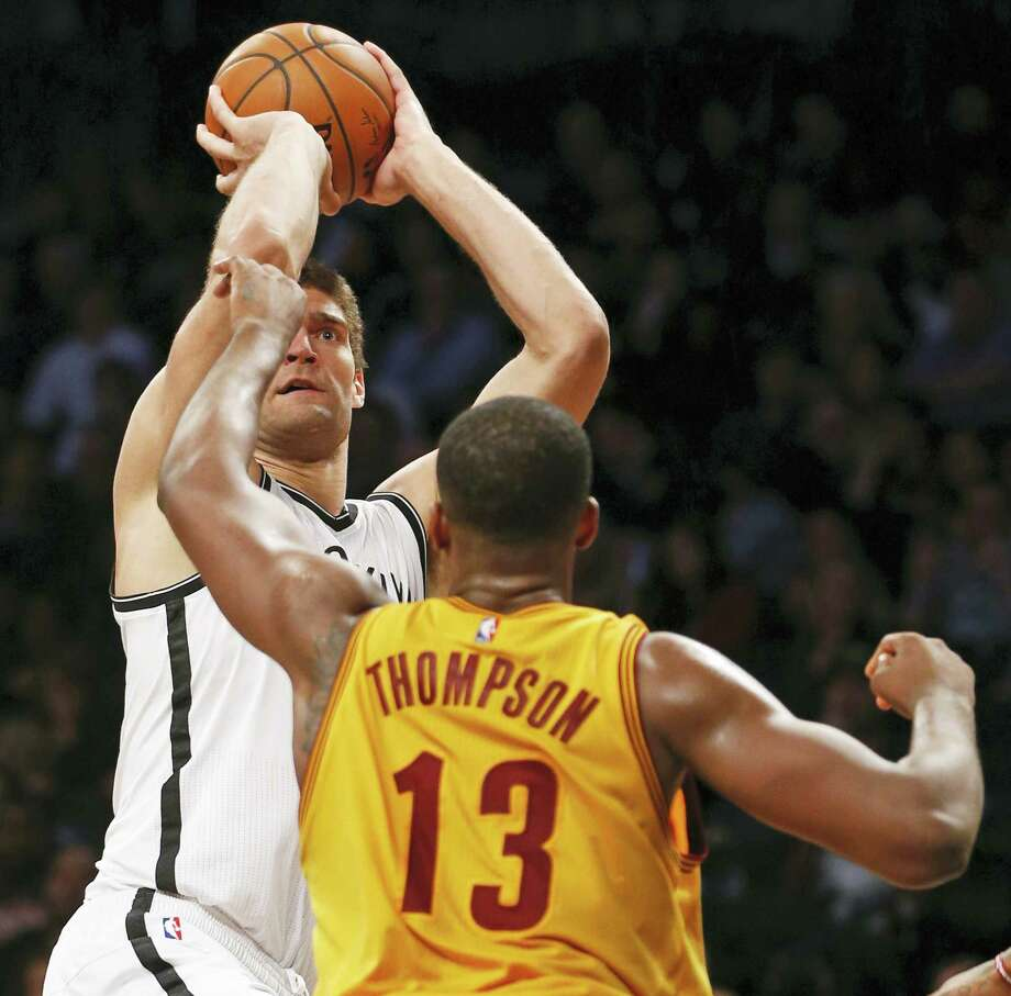 Cleveland Cavaliers center Tristan Thompson (13) defends Brooklyn Nets center Brook Lopez (11) in the second half of an NBA basketball game, Thursday, March 24, 2016, in New York. Lopez had 22 points as the the Nets beat the Cavaliers 104-95. (AP Photo/Kathy Willens) Photo: AP / Copyright 2016 The Associated Press. All rights reserved. This material may not be published, broadcast, rewritten or redistributed without permission.