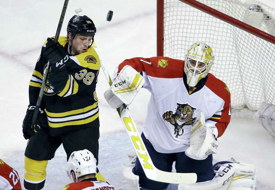 Boston Bruins left wing Matt Beleskey (39) watches as Florida Panthers goalie Roberto Luongo (1) deflects the puck in the first period of an NHL hockey game, Thursday, March 24, 2016, in Boston. (AP Photo/Elise Amendola) Photo: AP / Copyright 2016 The Associated Press. All rights reserved. This material may not be published, broadcast, rewritten or redistributed without permission.