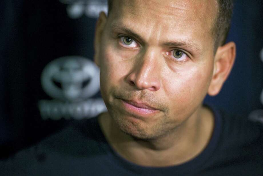 New York Yankees' Alex Rodriguez talks with reporters outside the clubhouse before a spring training baseball game with the Tampa Bay Rays, Thursday, March 24, 2016, in Tampa, Fla. (AP Photo/Steve Nesius) Photo: AP / FR69810 AP