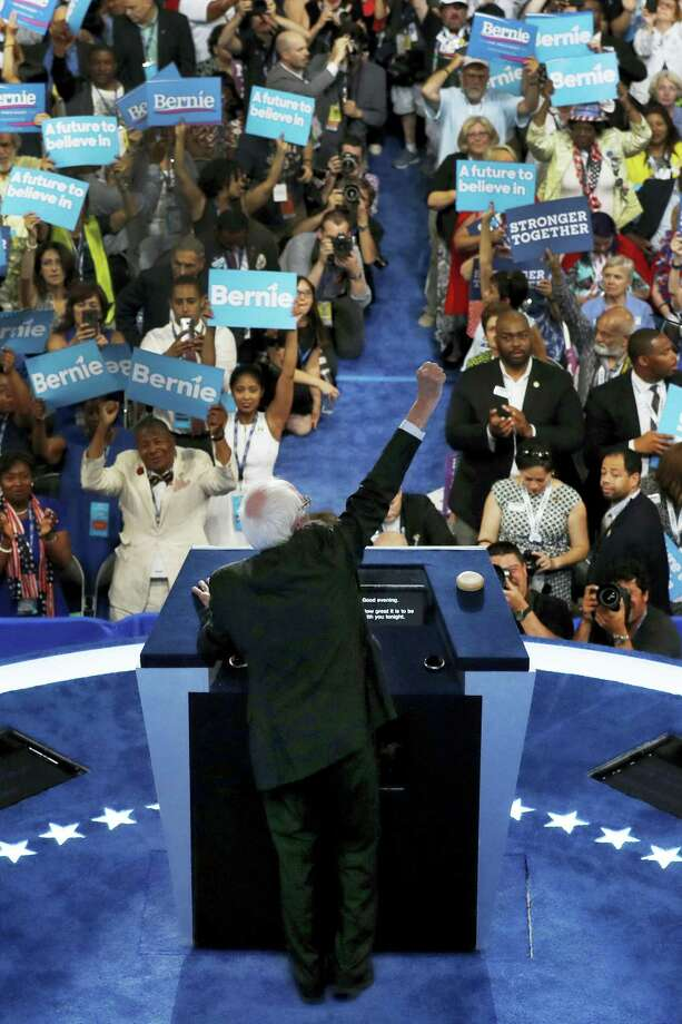 Former Democratic presidential candidate, Sen. Bernie Sanders, I-Vt., pumps his fist in the air as he addresses the first day of the Democratic National Convention in Philadelphia , Monday, July 25, 2016. Photo: AP Photo/Mary Altaffer   / Copyright 2016 The Associated Press. All rights reserved. This material may not be published, broadcast, rewritten or redistribu