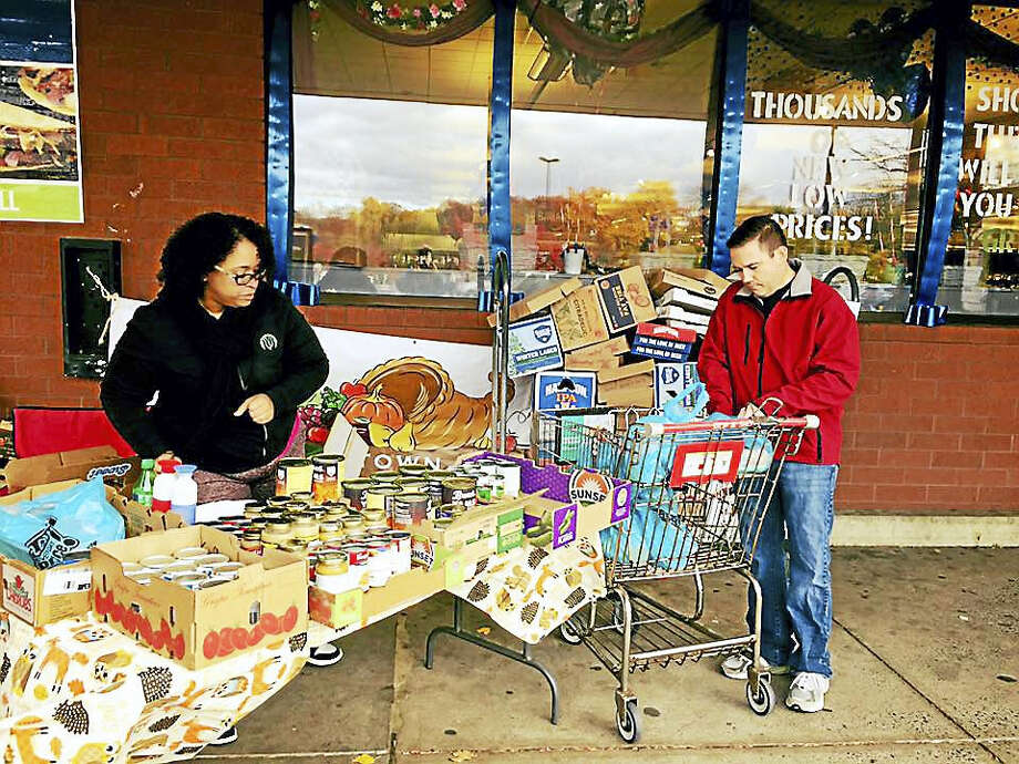 This year, more than 950 baskets of food were assembled by volunteers working in conjunction with the Middlesex United Way for the Middletown Community Thanksgiving Project. Here, canned goods are collected at Stop & Shop on East Main Street in Middletown last week. Photo: Courtesy Photo