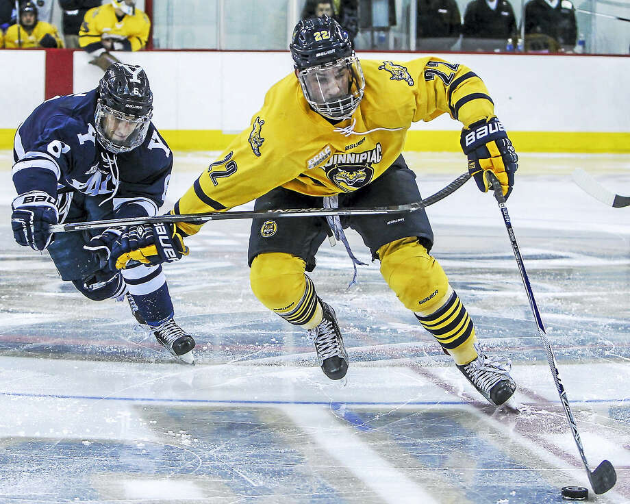 Quinnipiac's Scott Davidson fends off Yale's Stu Wilson during a game earlier this season. Photo: John Vanacore — Register File Photo  / (c)John H.Vanacore/Register