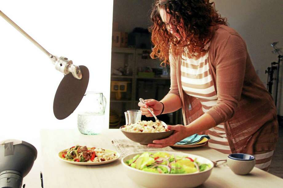 Stacey Genaw, set stylist for Taste of Home Magazine, is busy styling the food for a photo shoot. Photo: Photo Courtesy Of Taste Of Home