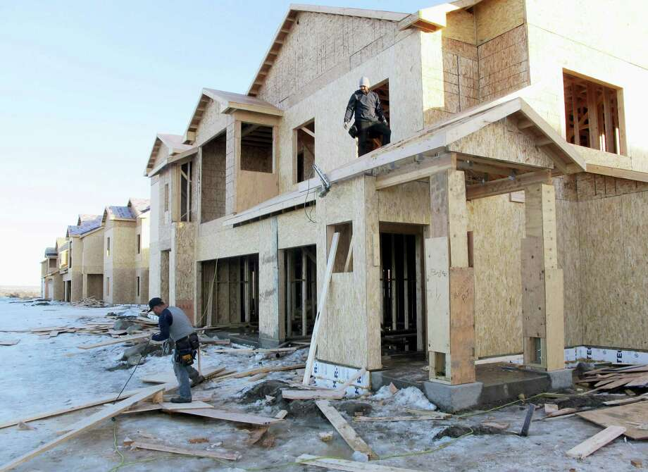 In this Jan. 29, 2016 photo, carpenters work on an apartment complex in Williston, N.D. Photo: AP Photo/James MacPherson, File  / Copyright 2016 The Associated Press. All rights reserved. This material may not be published, broadcast, rewritten or redistribu