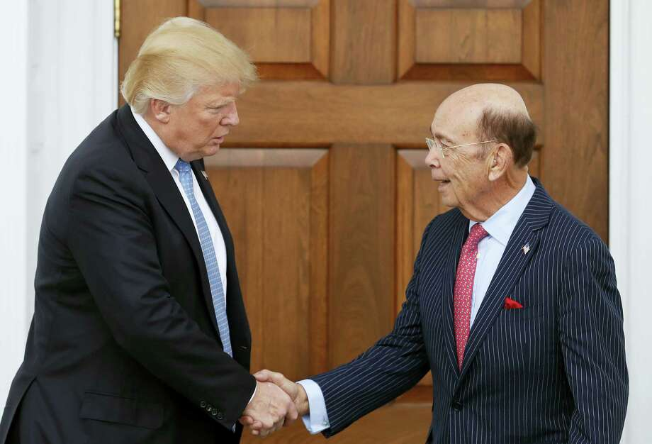 President-elect Donald Trump, left, shakes hands with investor Wilbur Ross after meeting at the Trump National Golf Club Bedminster clubhouse, Sunday, Nov. 20, 2016, in Bedminster, N.J. Photo: AP Photo/Carolyn Kaster   / Copyright 2016 The Associated Press. All rights reserved.