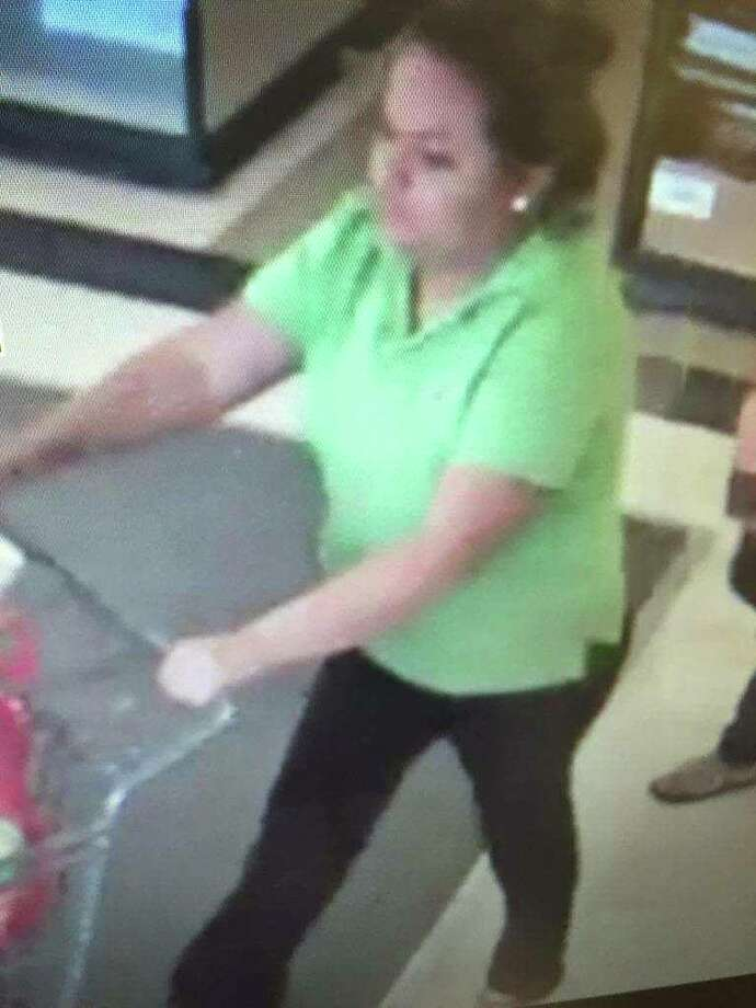 This woman is wanted for questioning for allegedly taking a money envelope from a store counter. Photo: Courtesy Photo
