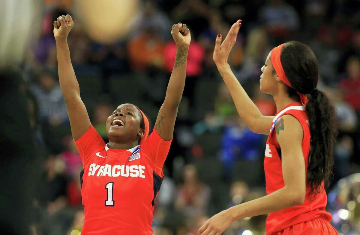 Syracuse's Alexis Peterson (1) and Briana Da, right, celebrate following Friday's win over top-seeded South Carolina.