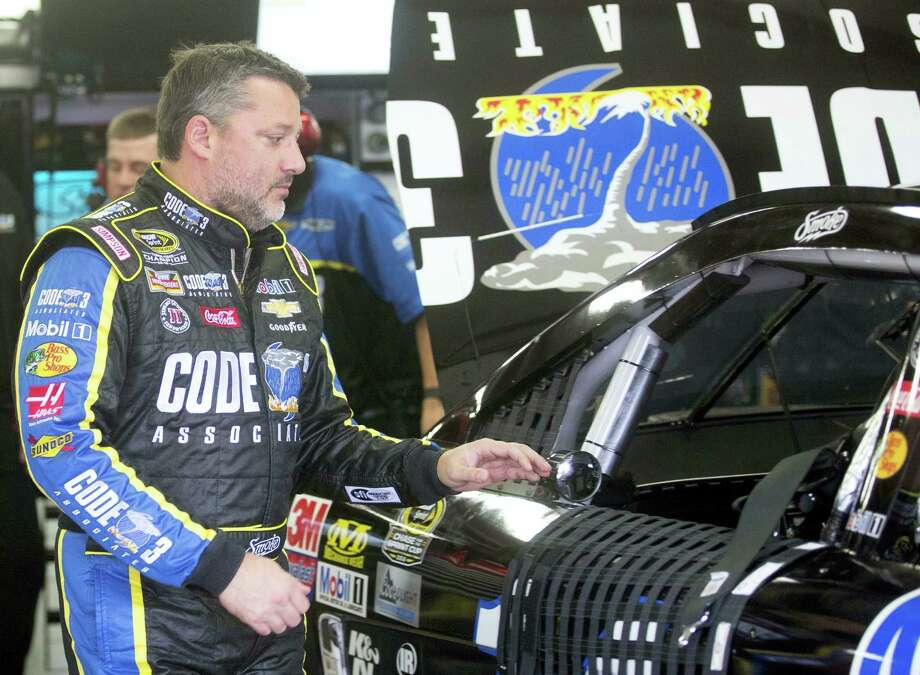 Tony Stewart gets ready to climb into his car for practice for Sunday's race at New Hampshire Motor Speedway. Photo: Jim Cole — The Associated Press  / Copyright 2016 The Associated Press. All rights reserved.