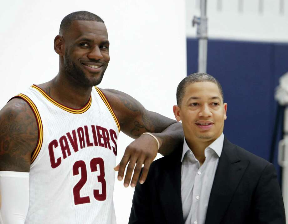 Cavaliers forward LeBron James (23) and head coach Tyronn Lue pose for photos during the team's media day on Monday. Photo: Ron Schwane — The Associated Press  / AP 2016