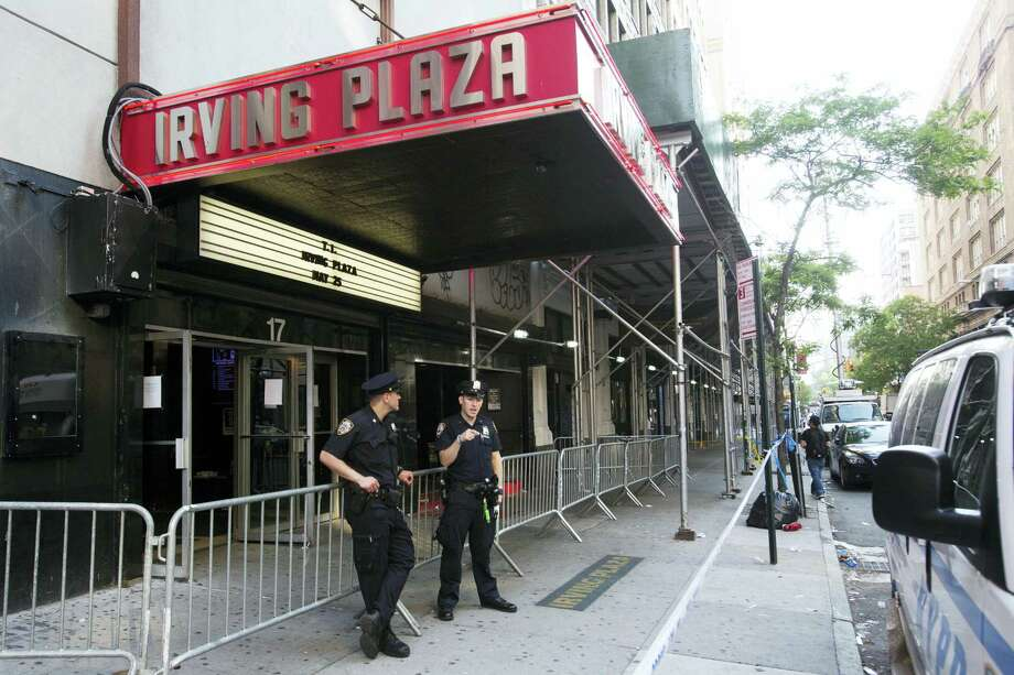 Police officers stand outside Irving Plaza, Thursday, May 26, 2013 in New York. Shots rang out inside the concert venue Wednesday night, where hip-hop artist T.I. was getting ready to perform. Photo: AP Photo — Mark Lennihan / Copyright 2016 The Associated Press. All rights reserved. This material may not be published, broadcast, rewritten or redistribu