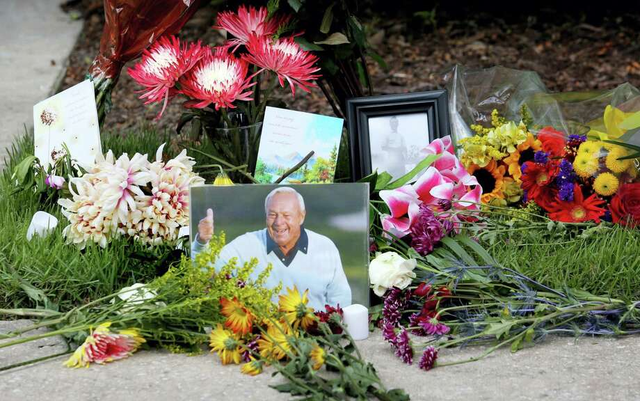 Flowers and mementos adorn a makeshift memorial honoring the late golf great Arnold Palmer at Palmer's parking spot at the Golf Channel studios in Orlando, Fla., Monday. Photo: Joe Burbank — The Orlando Sentinel  / Orlando Sentinel