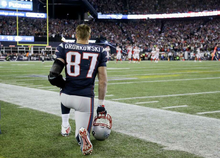 Patriots tight end Rob Gronkowski watches from the sidelines. Photo: Elisa Amendola — The Associated Press   / AP