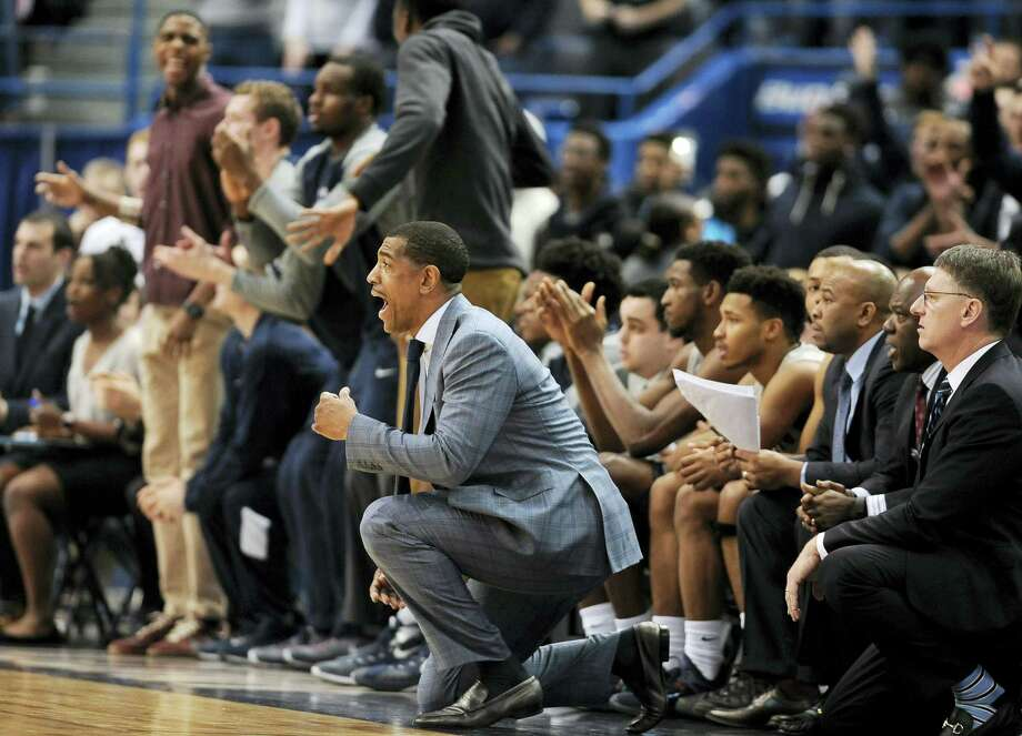 UConn coach Kevin Ollie reacts in the second half of Saturday's game. Photo: Jessica Hill — The Associated Press  / FR125654 AP