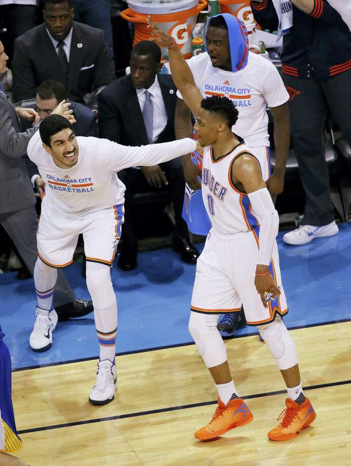 Oklahoma City Thunder guard Russell Westbrook (0) celebrates with teammate Enes Kanter, left, following a basket against the Golden State Warriors in Game 4 of the NBA basketball Western Conference finals in Oklahoma City, on May 24, 2016. The Thunder won 118-94. Photo: AP Photo/Sue Ogrocki  / AP2016
