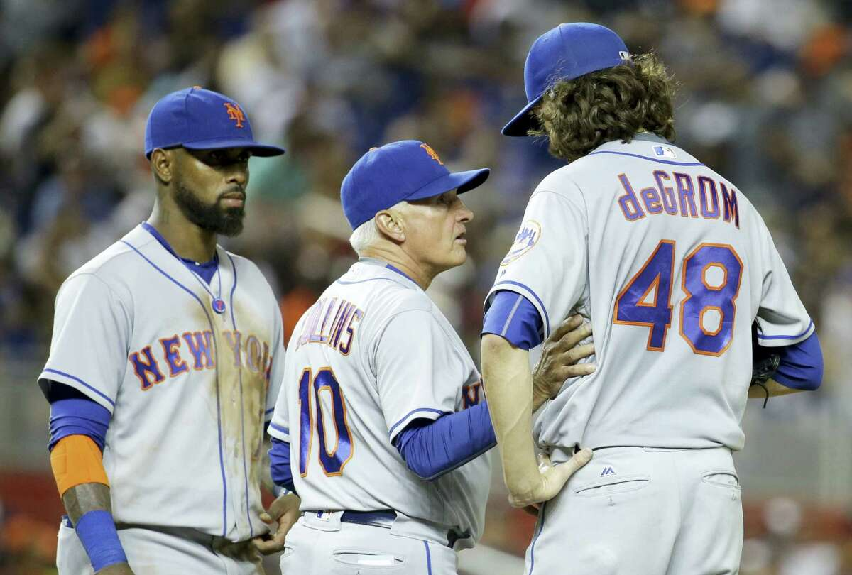 New York Mets manager Terry Collins (10) talks with starting pitcher Jacob deGrom during a recent game.