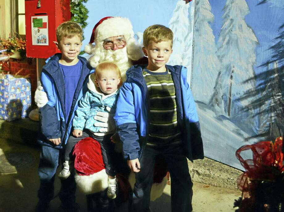 Santa Claus poses for photographs with children during 2015's Holiday on Main in Middletown. The right jolly old elf will be stationed in front of the Middlesex County Chamber of Commerce at 393 Main St. on Friday evening. Events begin at 4 p.m. downtown. Photo: File Photo