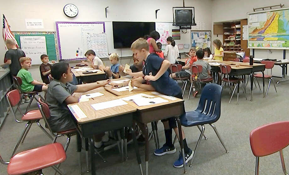 In this Sept. 13, 2016 still image from video, students attend the fourth grade class of Kimberly Coleman-Mitchell at Oakridge Elementary School in Arlington, Va. Elementary schools in Arlington, South Burlington, Vt., and Holyoke, Mass., are among those that went homework-free at the start of the school year. Photo: AP Photo/Bill Gorman  / Copyright 2016 The Associated Press. All rights reserved.