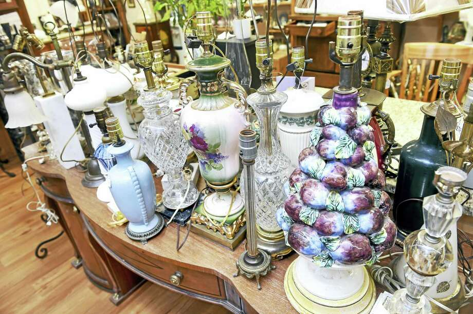 (Arnold Gold-New Haven Register)  A display of restored antique lamps at Lamp Shades-Plus in Orange on 7/22/2016. Photo: Journal Register Co.