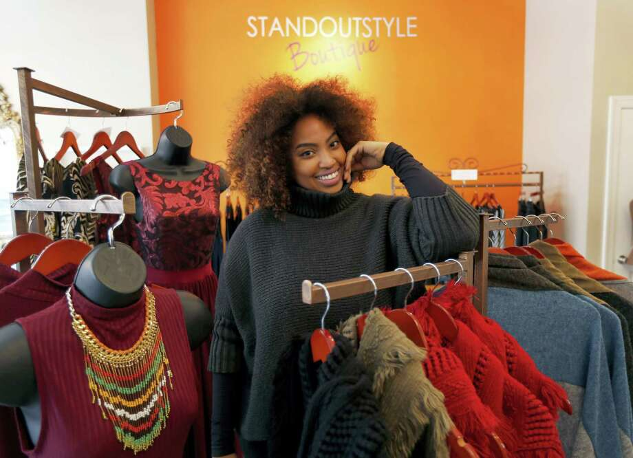 Tamika Maria Price poses for a portrait at her business, Standout Style Boutique, in Chicago's Lakeview neighborhood. A disappointing holiday shopping season has small and independent retailers thinking about how to get customers interested in shopping in 2016. Photo: Charles Rex Arbogast — The Associated Press  / AP