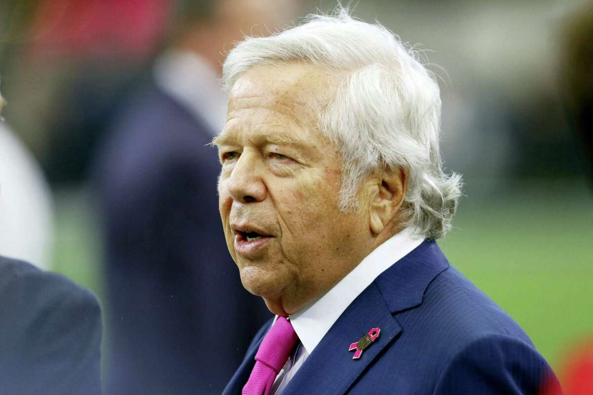This Oct. 11, 2015 photo shows New England Patriots Chairman and CEO, Robert Kraft talking with others on the field as the team warms up before an NFL football game against the Dallas Cowboys in Arlington, Texas. The chop block has been entirely outlawed from NFL games, and extra-point kicks snapped from the 15-yard line are now permanent. NFL owners voted Tuesday, March 22, 2016 to approve both those proposals by the competition committee. They also passed a resolution to expand what is a horse-collar tackle to cover the nameplate on the back of jerseys. (AP Photo/Roger Steinman)