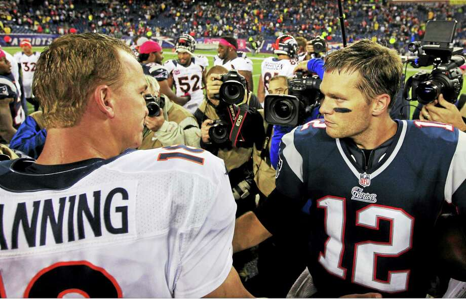 Broncos quarterback Peyton Manning, left, and Patriots quarterback Tom Brady, right, will square off for the 17th time on Sunday. Photo: Steven Senne — The Associated Press  / AP
