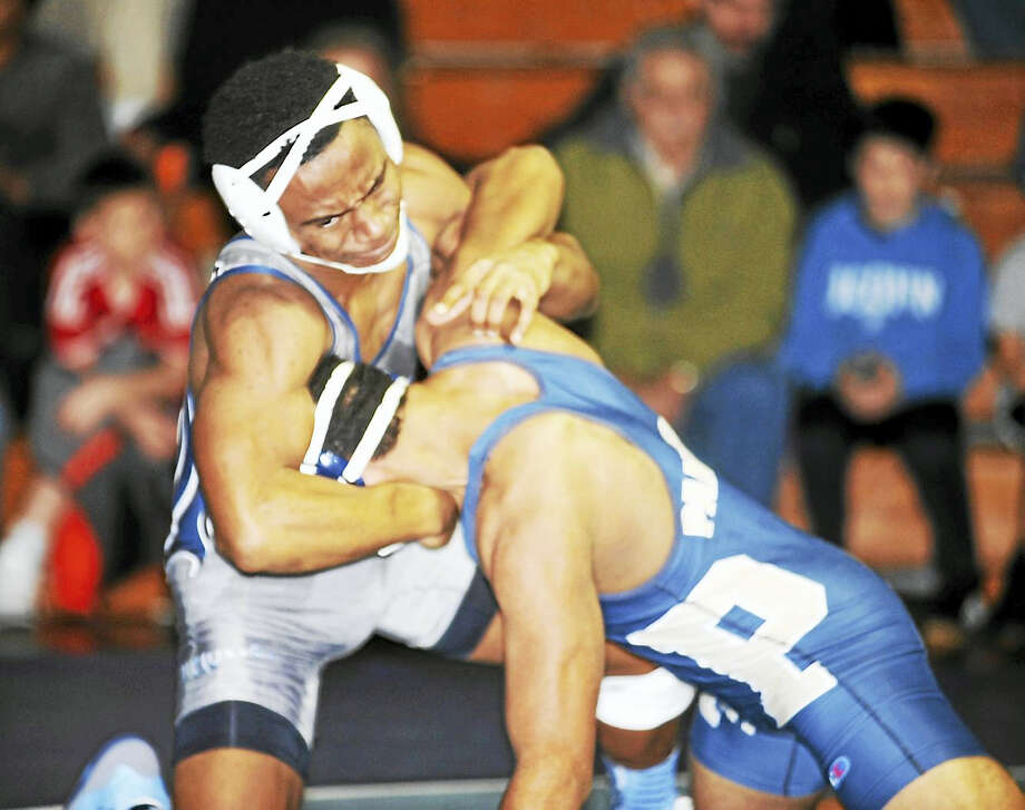 Blue Dragons senior Isaiah King looks to take down Platt sophomore Damian Morris in Thursday's CCC match at Middletown. Photo: Jimmy Zanor — The Middletown Press